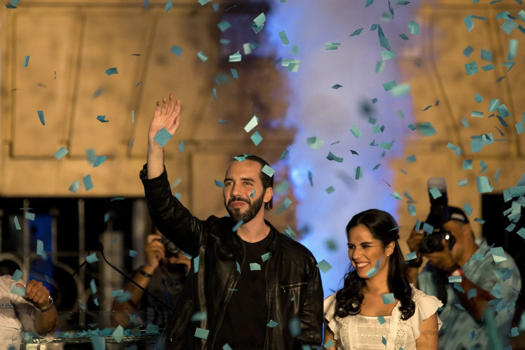 In this Feb. 3, 2019 photo, presidential candidate Nayib Bukele, of the Grand Alliance for National Unity, center left, accompanied by his wife Gabrie...