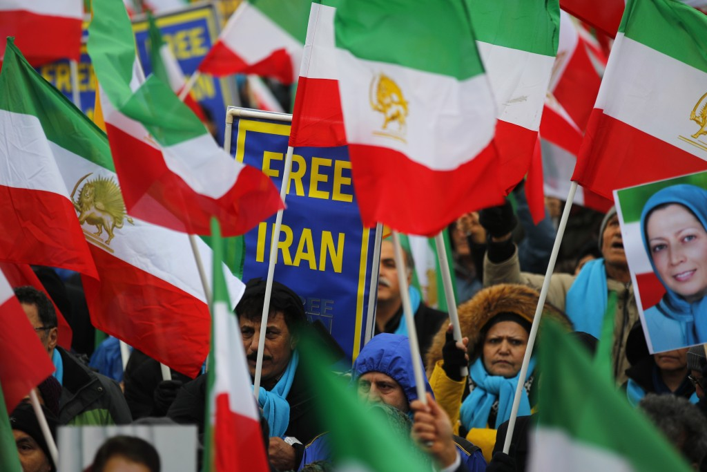 Supporters of Maryam Rajavi, the leader of the National Council of Resistance of Iran, demonstrate in Paris, Friday Feb.8, 2019 as Iran marks the 40th