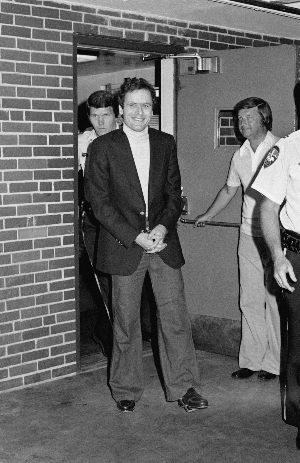 FILE - In this June 13, 1977 file photo, Ted Bundy appears in cuffs after being recaptured just outside of Aspen City limits. He was pulled over by th