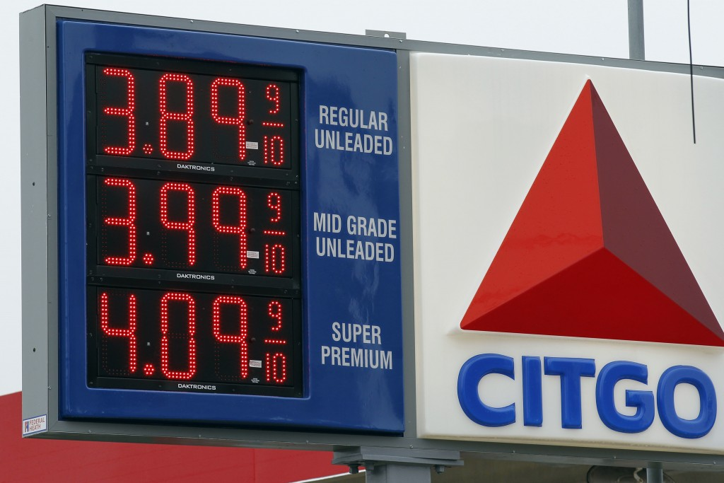 FILE - In this Feb. 24, 2012 file photo, gas prices are posted at the Citgo gas station in Philadelphia. U.S. refiners like Citgo are among the few cu