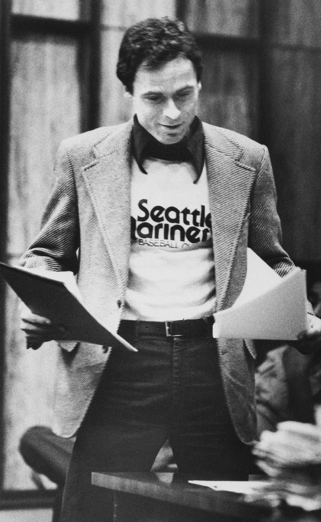 FILE - In this July 5, 1979 file photo, accused serial killer Ted Bundy wears a Seattle Mariners T-shirt in court in Miami, as he presents is own moti