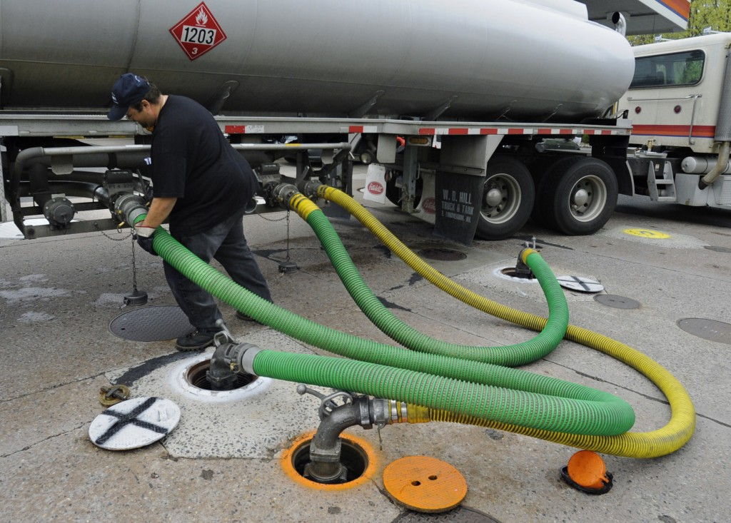 FILE - In this April 28, 2011 file photo, a truck delivers gas to a Citgo station in Wethersfield, Conn. U.S. refiners like Citgo are among the few cu
