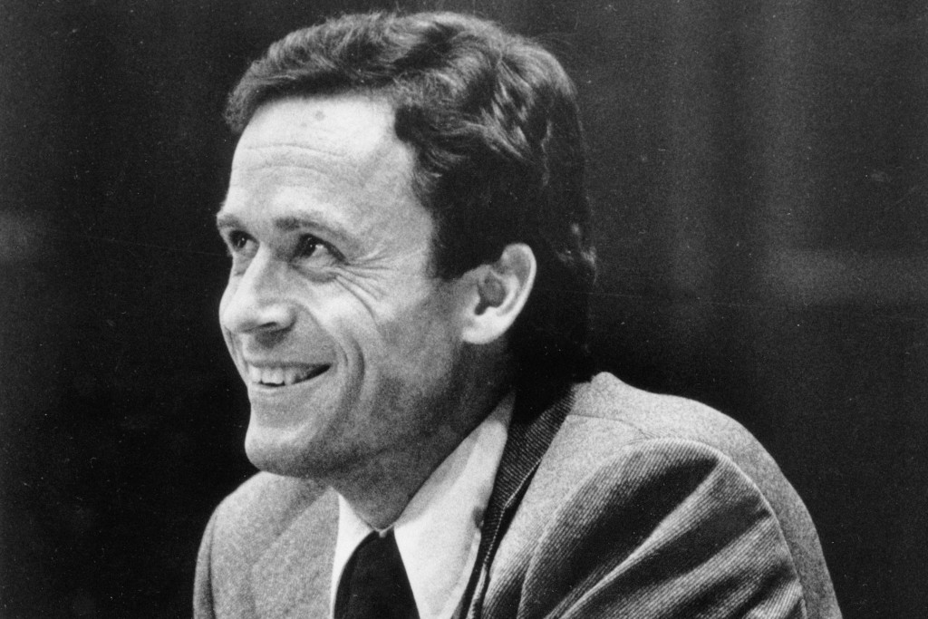 FILE - In this June 27, 1979 file photo, Ted Bundy smiles during the second day of jury selection for his murder trial in a Dade County courtroom in M