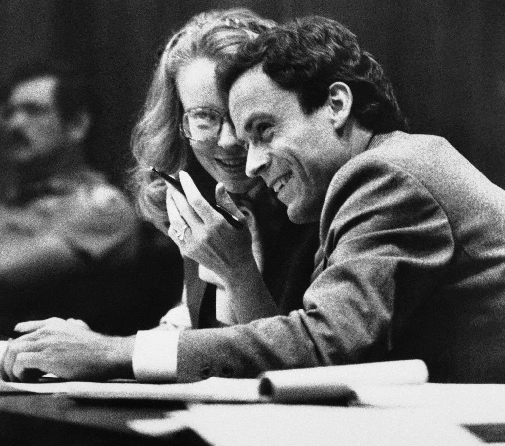 FILE - In this July 6, 1979 file photo, Ted Bundy, right, confers with Margaret Good, a member of his defense team, during jury selection for Bundy's