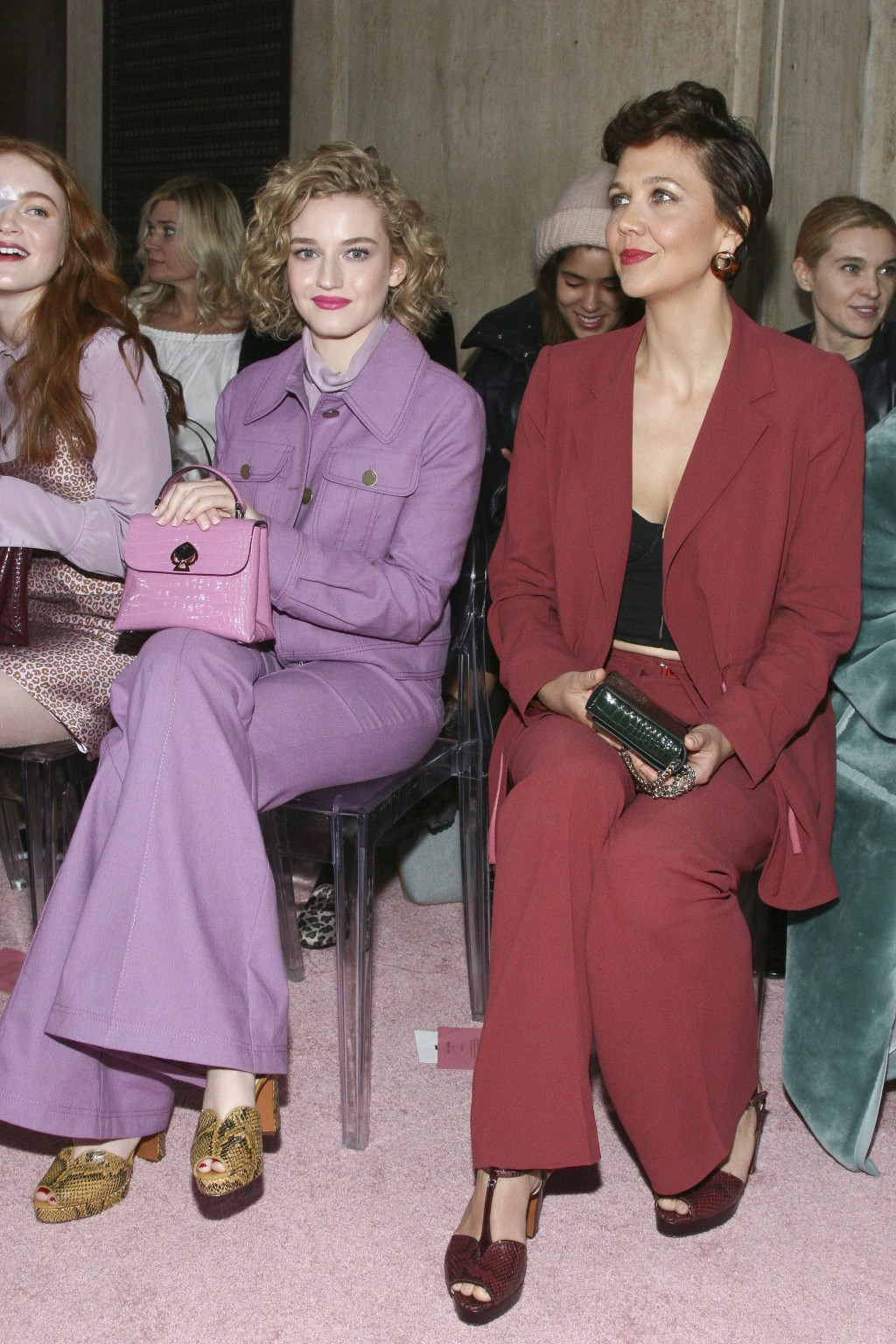 Julia Garner, left, and Maggie Gyllenhaal, right, attend the NYFW Fall/Winter 2019 Kate Spade fashion show at the Cipriani's on Friday, Feb. 8, 2019,