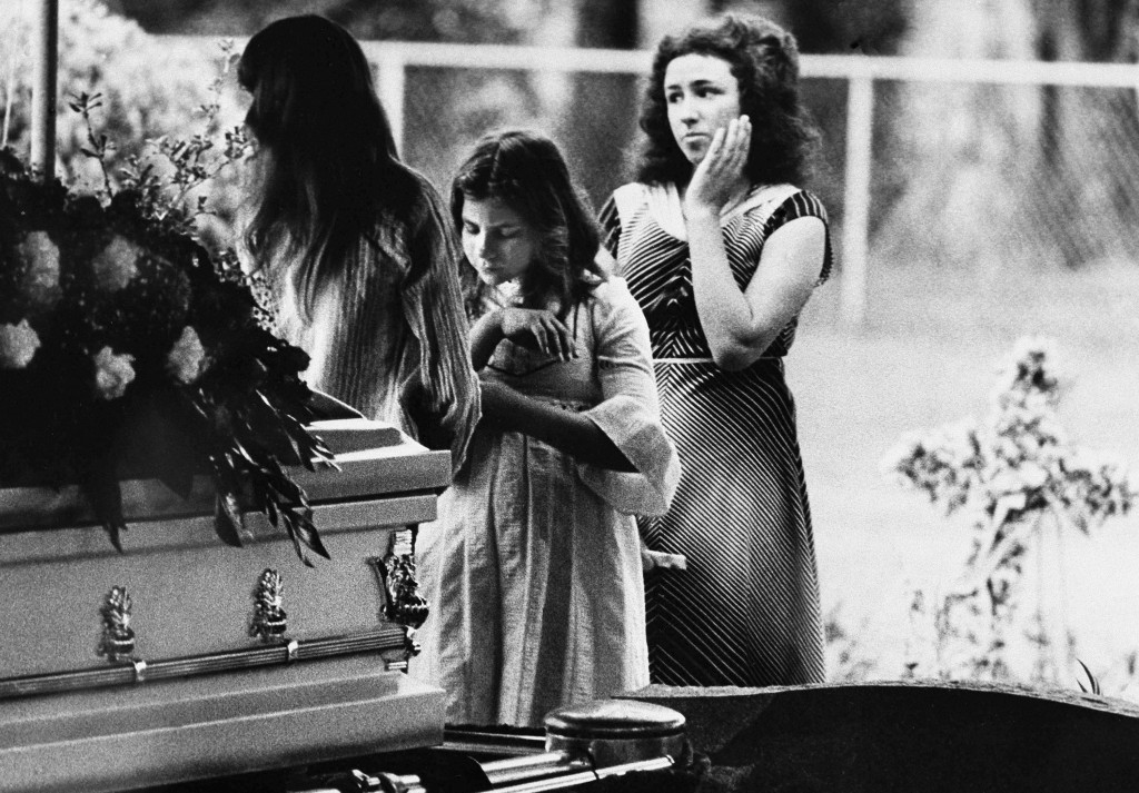 FILE - In this April 13, 1978 file photo, mourners say goodbye to Kimberly Leach at the funeral for the 12-year-old girl in Lake City, Fla. She disapp