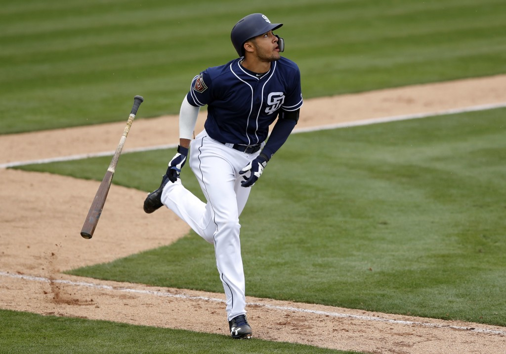 FILE - In this Friday, Feb. 23, 2018, file photo, San Diego Padres' Fernando Tatis runs up the first baseline after hitting a home run in the eighth i...
