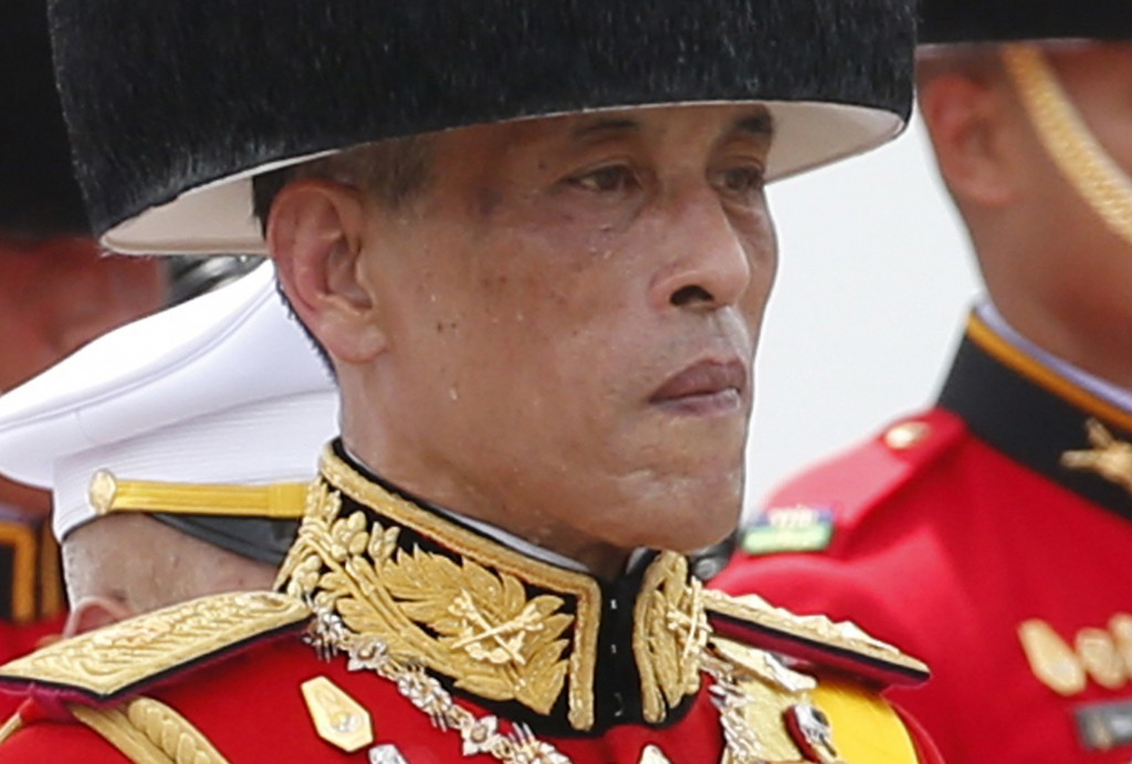 FILE - In this Oct. 26, 2017, file photo, Thailand's King Maha Vajiralongkorn walks in a funeral procession of his father the late King Bhumibol Aduly...