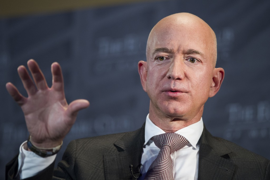 FILE- In this Sept. 13, 2018, file photo Jeff Bezos, Amazon founder and CEO, speaks at The Economic Club of Washington's Milestone Celebration in Wash