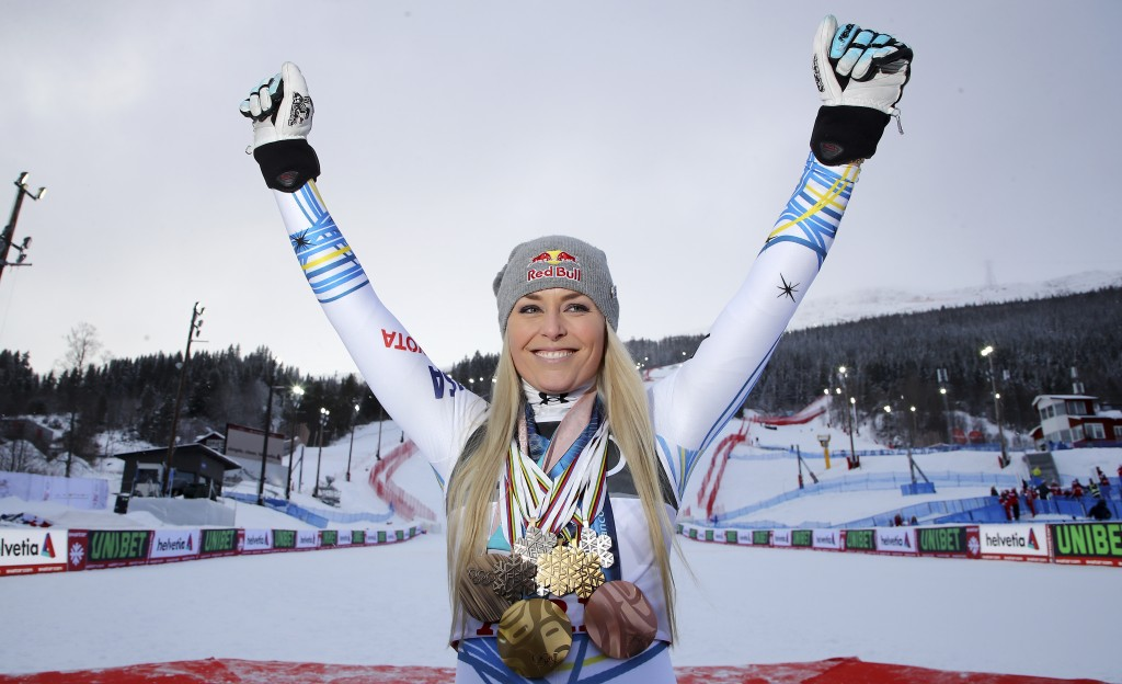United States' Lindsey Vonn poses with her career's medals in the finish area after the women's downhill race, at the alpine ski World Championships i...