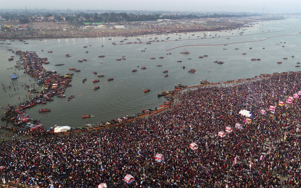 In this Sunday, Feb. 10, 2019, file photo, thousands of Hindu pilgrims take a ritualistic dip on the auspicious day of Basant Panchami at Sangam, the ...