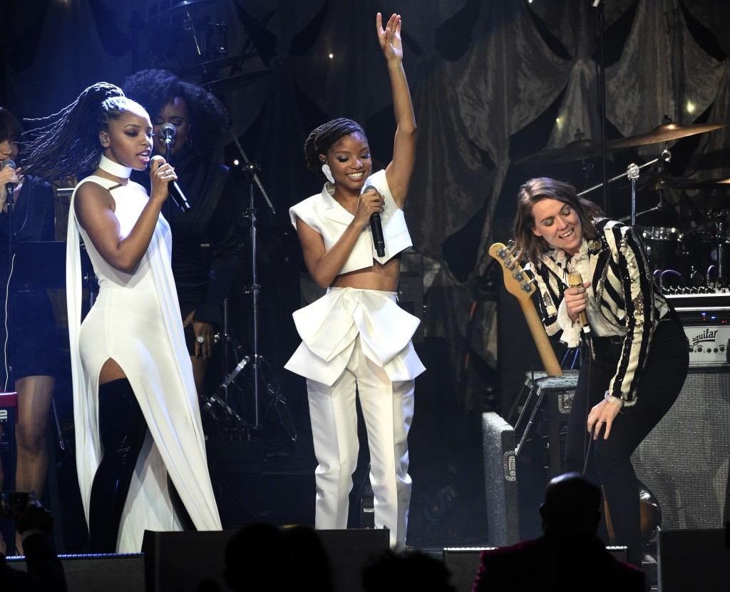 Chloe Bailey, from left, Halle Bailey, and Brandi Carlile perform at the Pre-Grammy Gala And Salute To Industry Icons at the Beverly Hilton Hotel on S