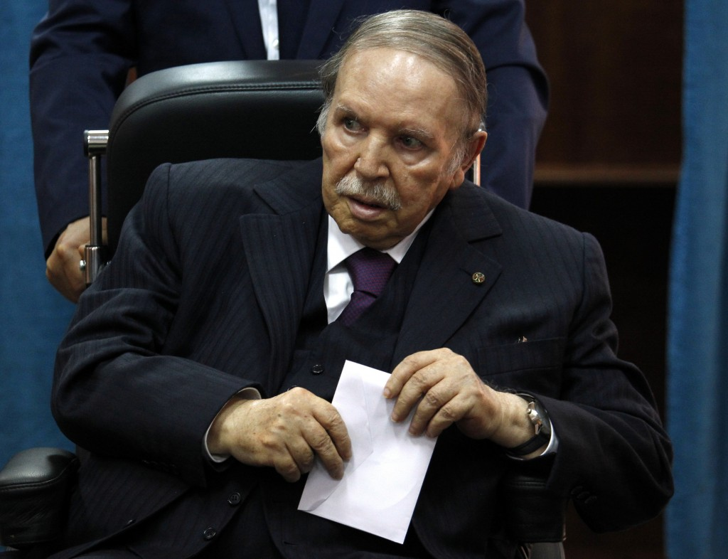 FILE - In this May 4, 2017, file photo, Algerian President Abdelaziz Bouteflika prepares to vote in Algiers. More than 180 people want to run for pres...
