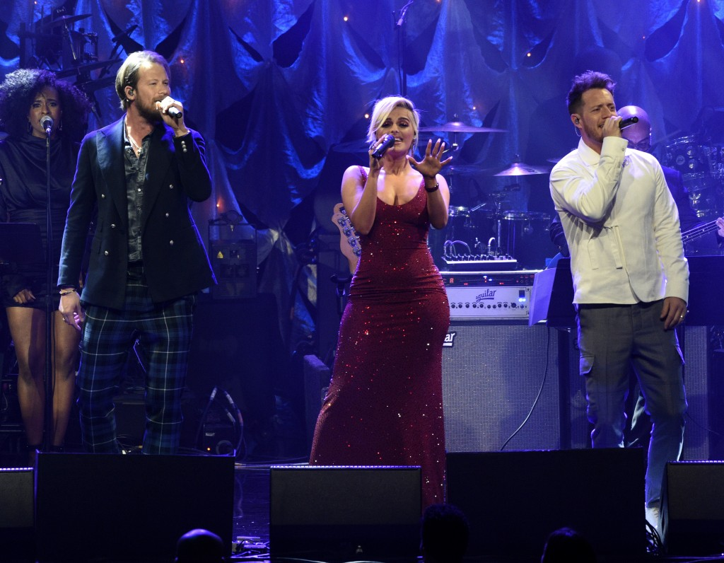 Bebe Rexha, center, and Florida Georgia Line perform at the Pre-Grammy Gala And Salute To Industry Icons at the Beverly Hilton Hotel on Saturday, Feb.