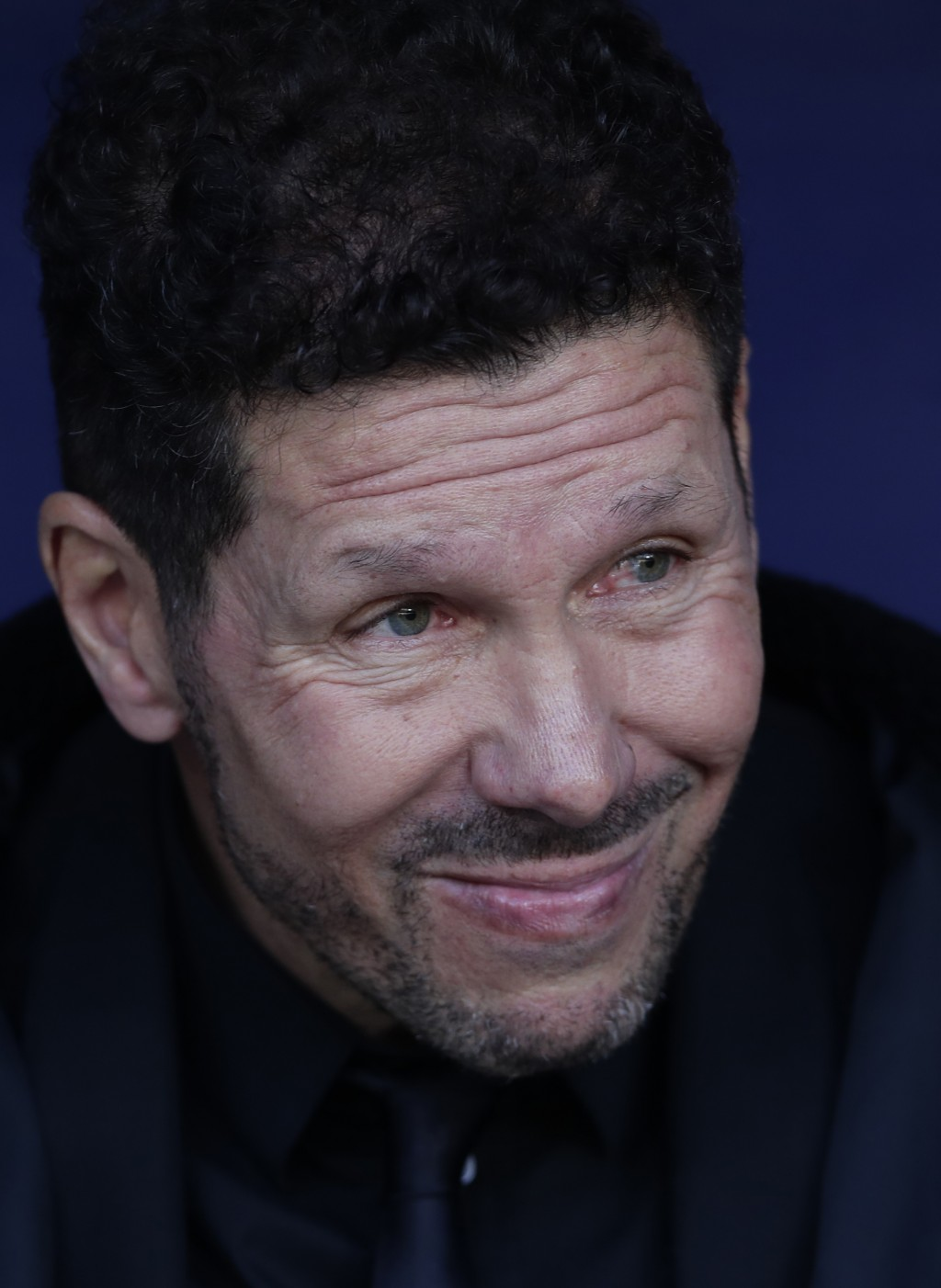 Atletico Madrid's head coach Diego Simeone waits for the start of a Spanish La Liga soccer match between Atletico Madrid and Real Madrid at the Metrop...