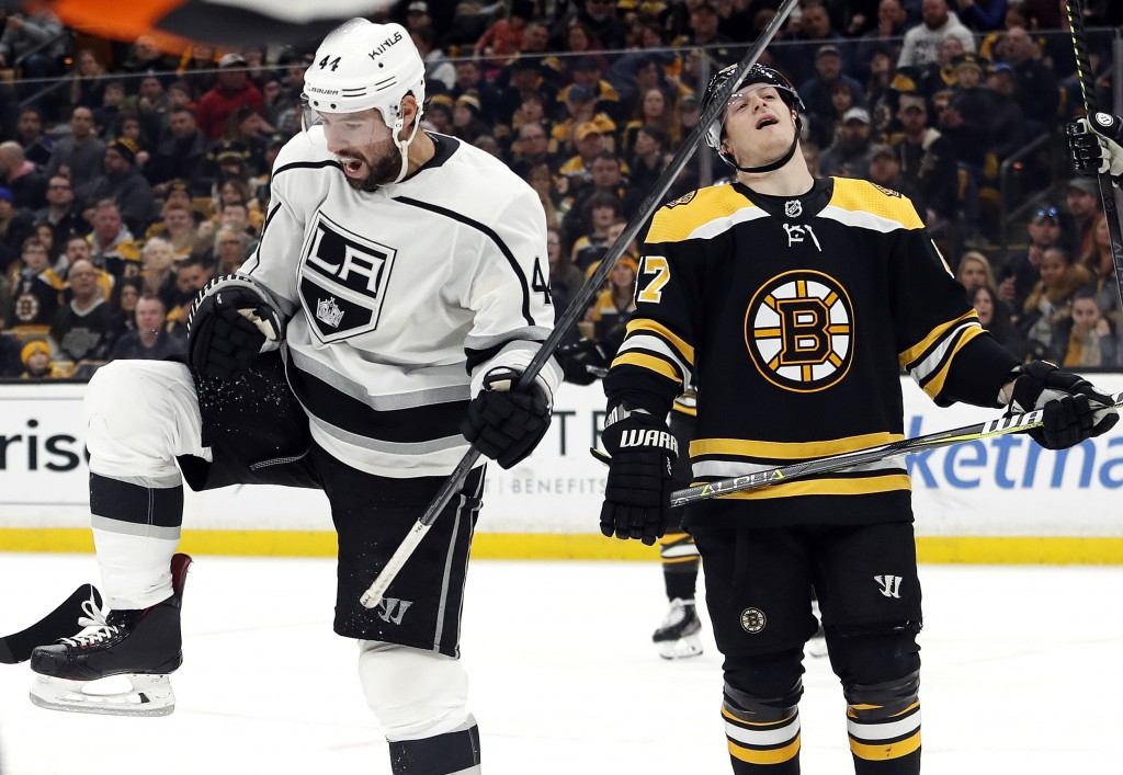 Los Angeles Kings' Nate Thompson, left, celebrates his goal next to Boston Bruins defenseman Torey Krug during the third period of an NHL hockey game ...
