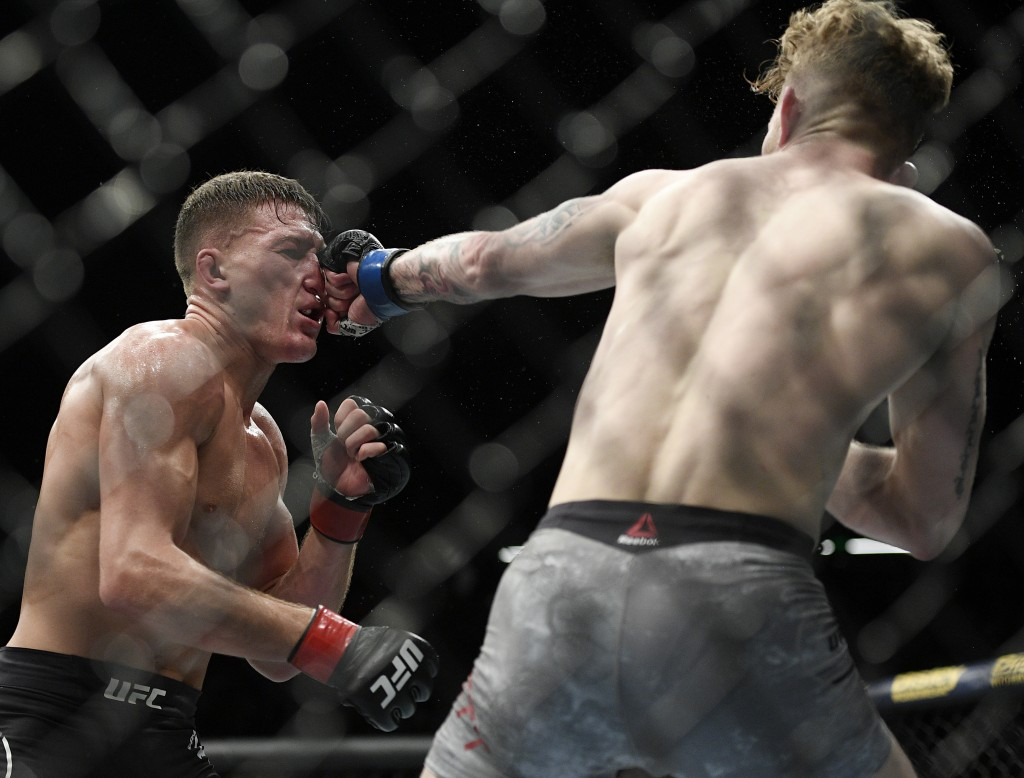 In this Sunday, Feb. 10, 2019, file photo, New Zealand's Shane Young, left, and Austin Arnett of the U.S., fight, during their featherweight bout at t...