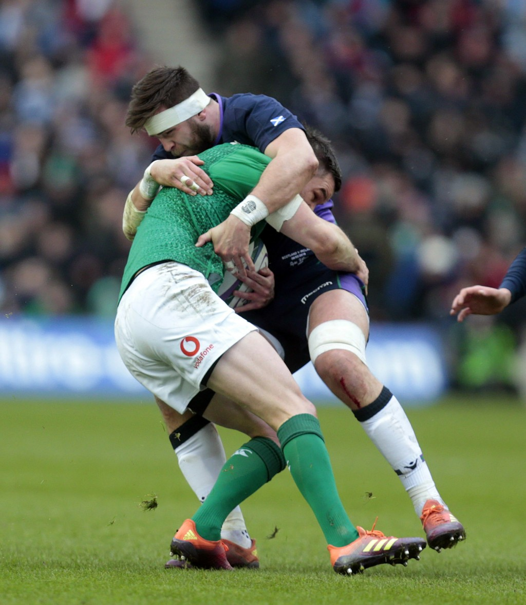 Scotland's Ryan Wilson, right, vies with Ireland's Jonny Sexton during the the Six Nations rugby union international match between Scotland and Irelan...