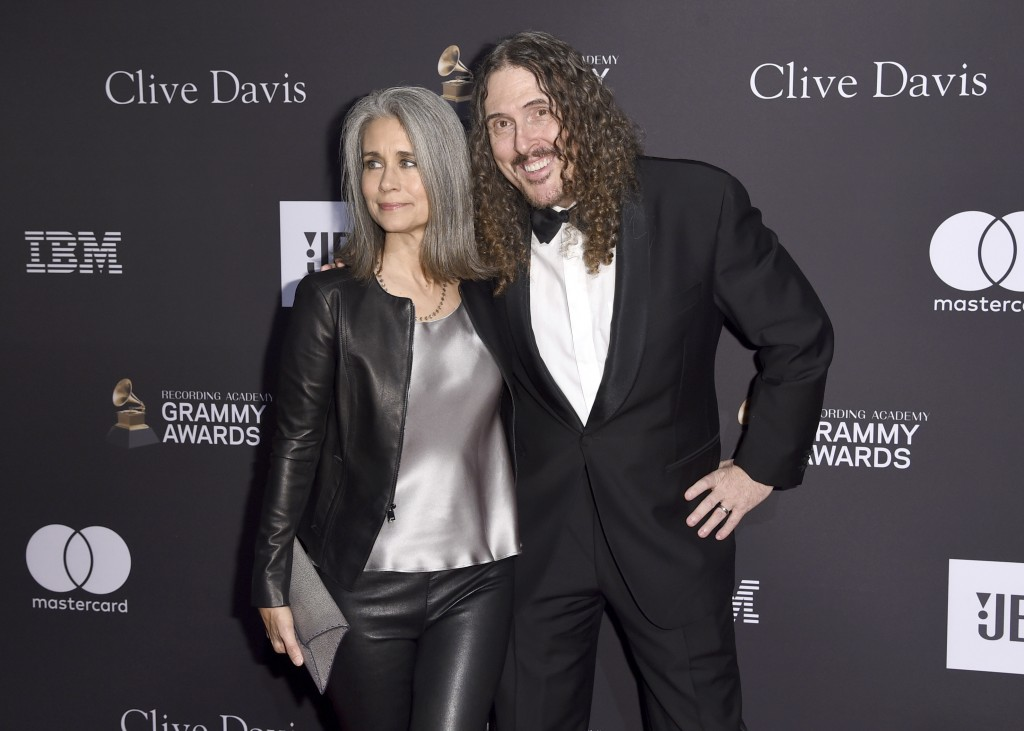 """Weird Al"" Yankovic, left, and Suzanne Yankovic arrive at the Pre-Grammy Gala And Salute To Industry Icons at the Beverly Hilton Hotel on Saturday, Fe"