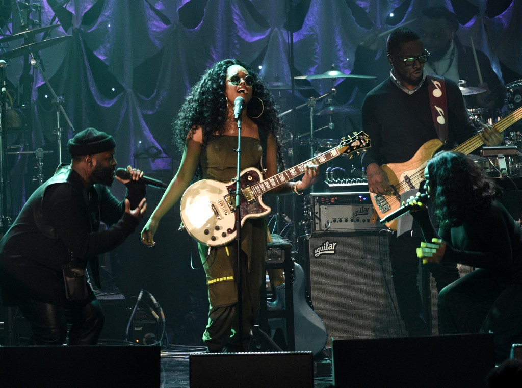 H.E.R. performs at the Pre-Grammy Gala And Salute To Industry Icons at the Beverly Hilton Hotel on Saturday, Feb. 9, 2019, in Beverly Hills, Calif. (P