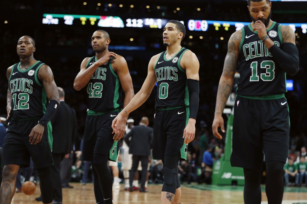Boston Celtics' Terry Rozier (12), Al Horford (42), Jayson Tatum (0) and Marcus Morris (13) walk to the bench during a timeout in the second half of t