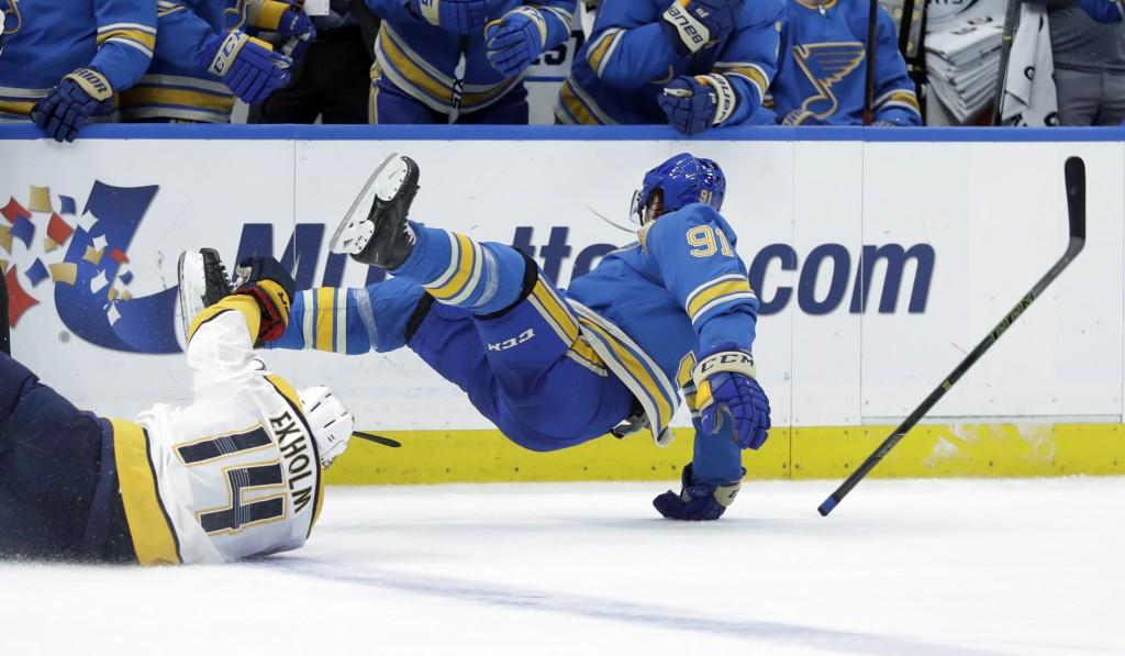 St. Louis Blues' Vladimir Tarasenko, of Russia, loses his stick after colliding with Nashville Predators' Mattias Ekholm (14), of Sweden, during the t