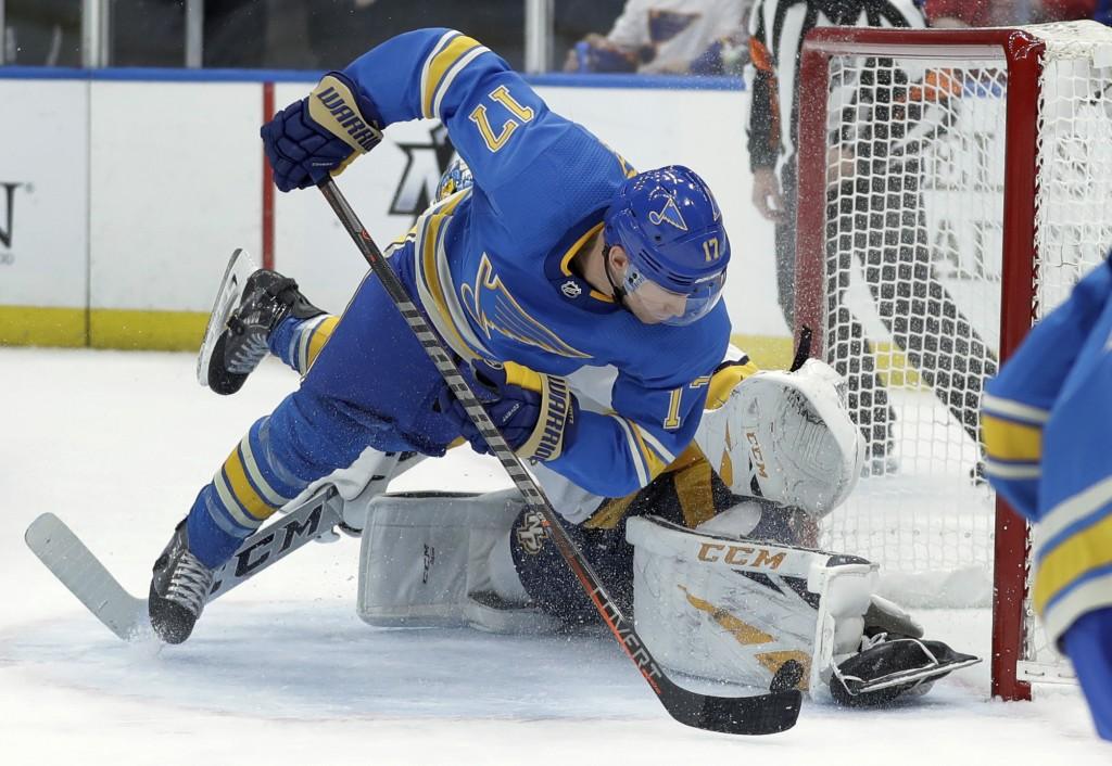 St. Louis Blues' Jaden Schwartz (17) is unable to score past Nashville Predators goaltender Pekka Rinne, of Finland, during the second period of an NH