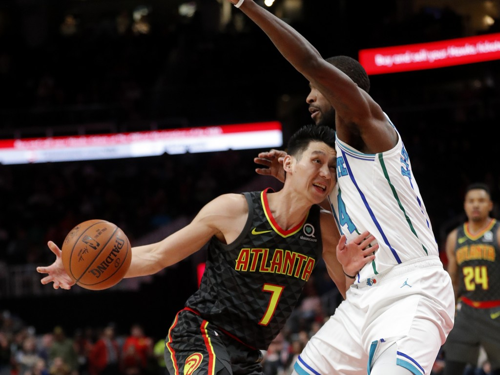 Atlanta Hawks guard Jeremy Lin (7) drives into Charlotte Hornets forward Michael Kidd-Gilchrist (14) during the first half of an NBA basketball Saturd...