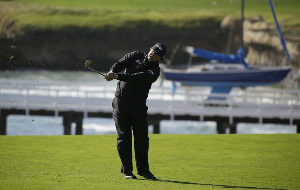 Phil Mickelson follows his approach shot from the fourth fairway of the Pebble Beach Golf Links during the final round of the AT&T Pebble Beach Pro-Am...