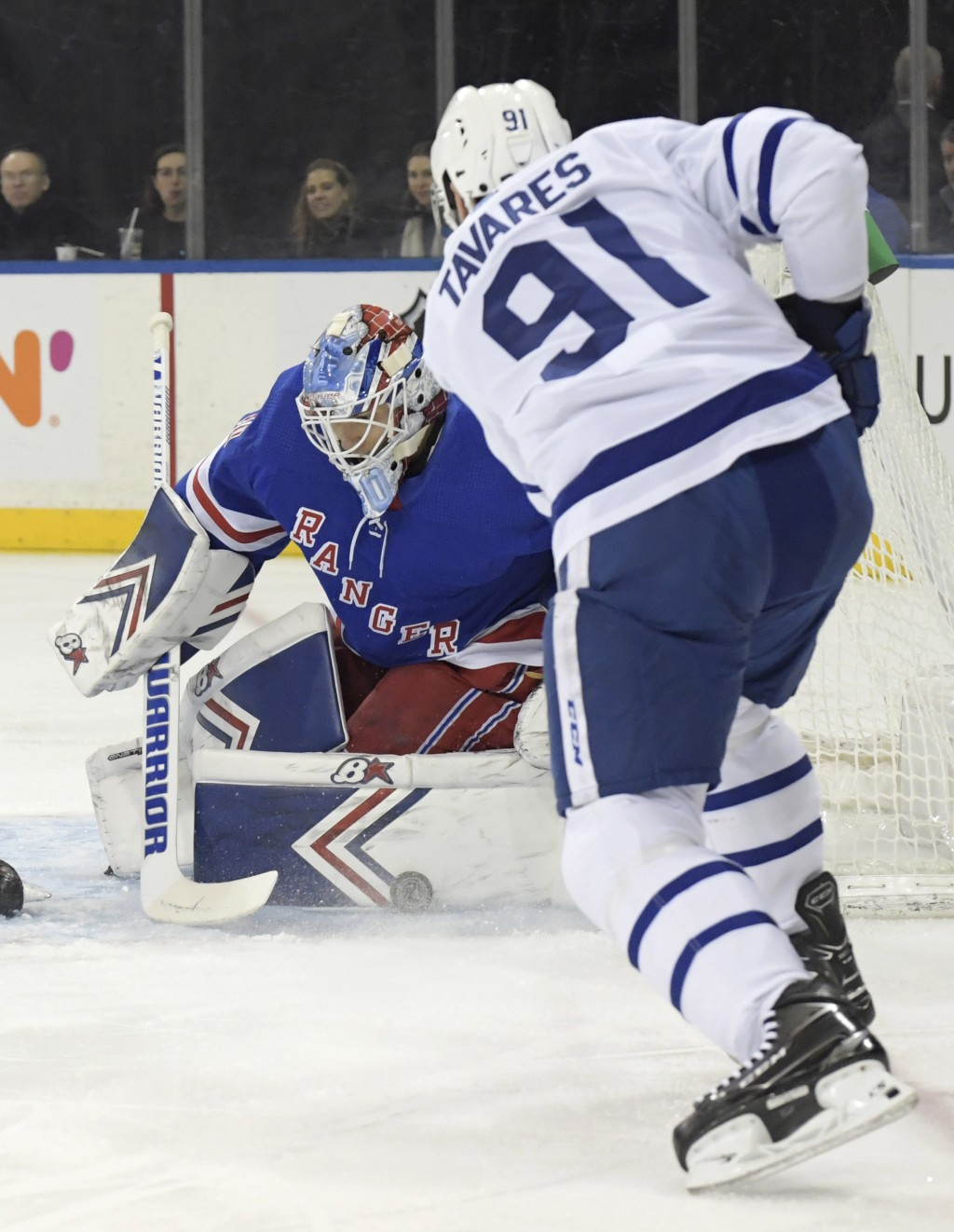 New York Rangers goaltender Alexandar Georgiev (40) makes a save on a shot by Toronto Maple Leafs center John Tavares (91) during the first period of