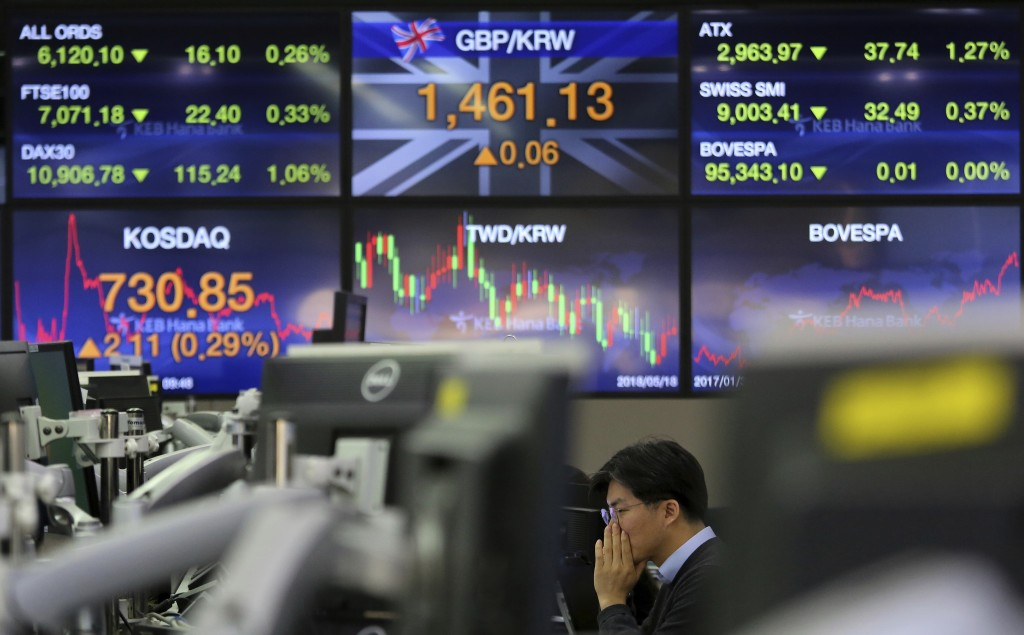 A currency trader watches monitors at the foreign exchange dealing room of the KEB Hana Bank headquarters in Seoul, South Korea, Monday, Feb. 11, 2019...