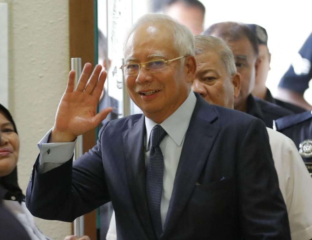 FILE - In this Oct. 4, 2018, file photo, former Malaysian Prime Minister Najib Razak walks into courtroom at Kuala Lumpur High Court in Kuala Lumpur,