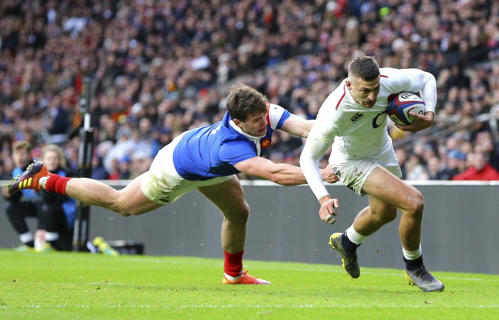 9aaa56d9320 England's Jonny May, right, breaks clear to score his second try of the game