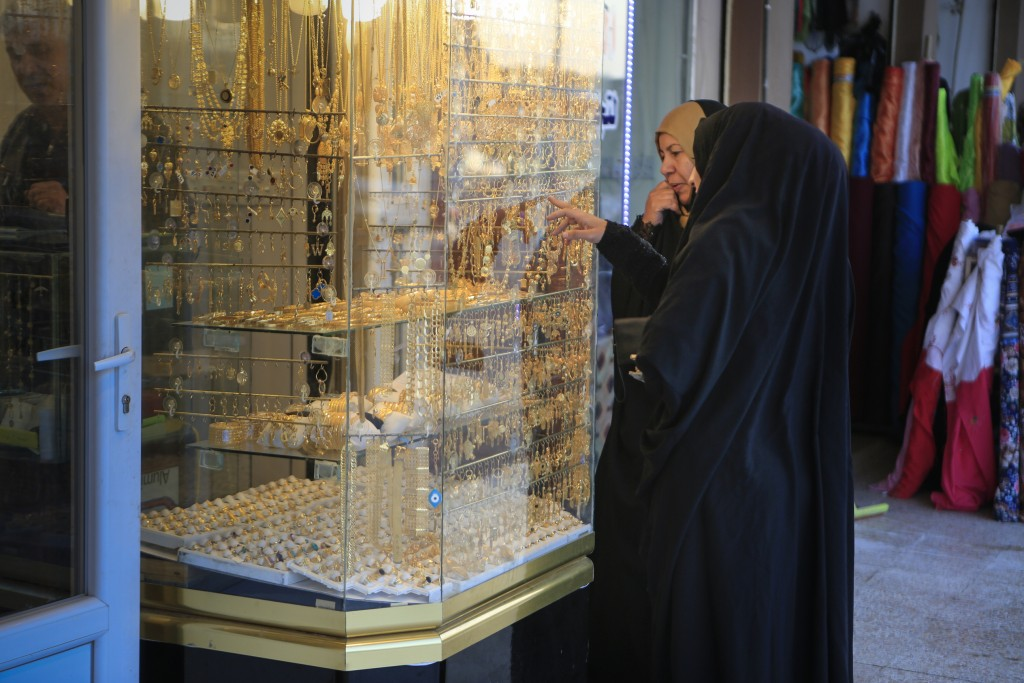 In this Jan. 18, 2019 photo, two women look at gold jewelry in the northern Iraqi town of Bartella, Iraq. Two years after it was liberated from Islami