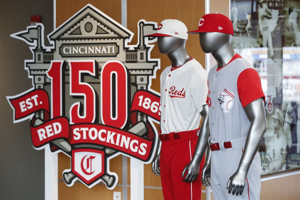 The Cincinnati Reds baseball team uniforms for the 2019 season are displayed at Great American Ball Park, Monday, Jan. 7, 2019, in Cincinnati. The Red