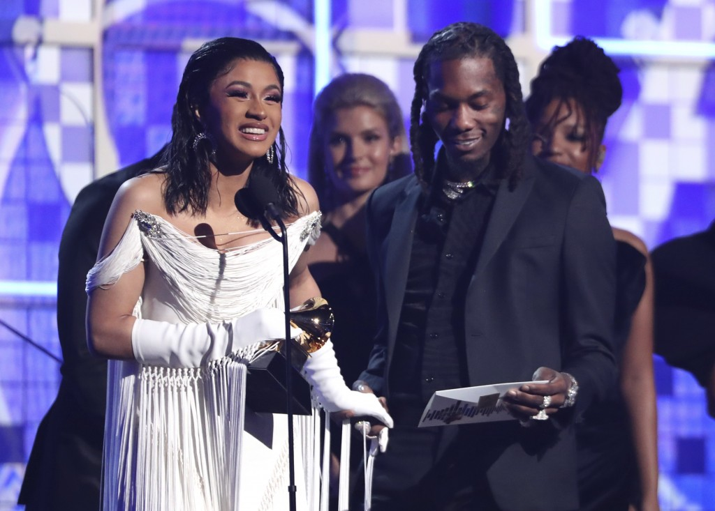 """Cardi B, left, accepts the award for best rap album for """"Invasion of Privacy"""" as Offset looks on at the 61st annual Grammy Awards on Sunday, Feb. 10, ..."""