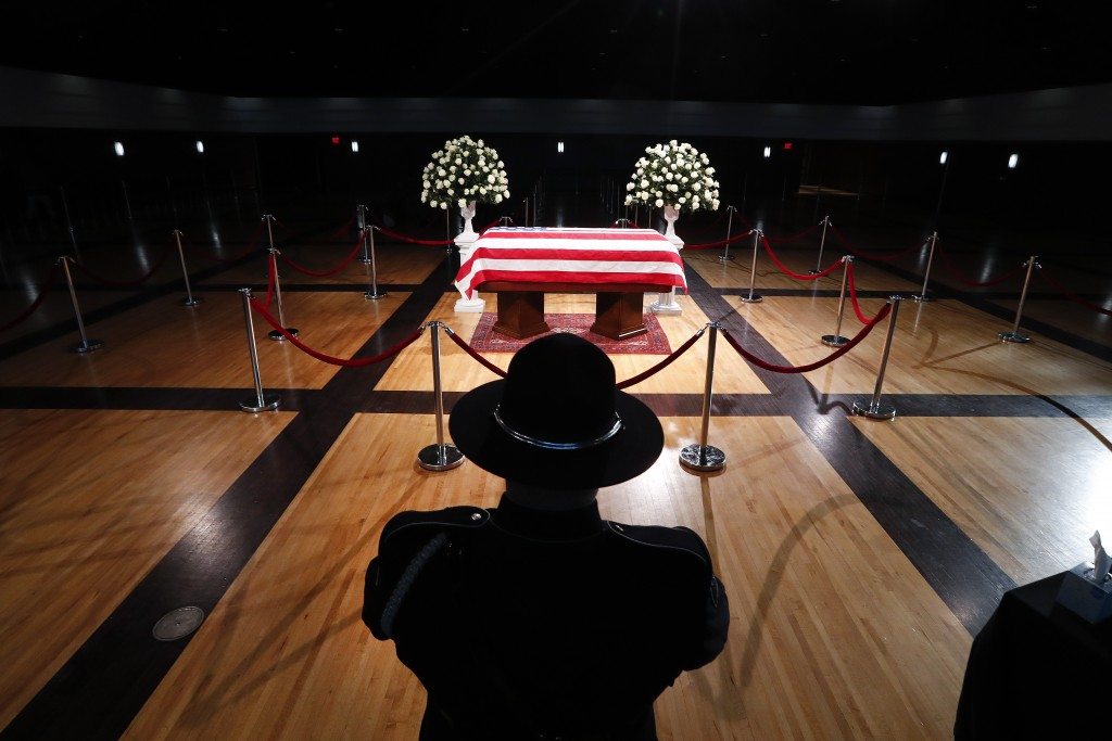 A police officer stands guard stands guard at the casket of former Michigan Rep. John Dingell, lying in repose in Dearborn, Mich., Monday, Feb. 11, 20...