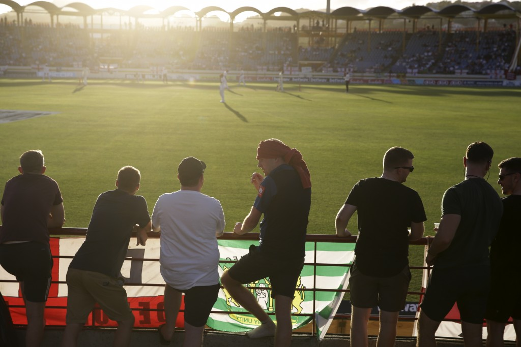 Spectators watch the last overs of day two of the third cricket Test match between England and West Indies at the Daren Sammy Cricket Ground in Gros I
