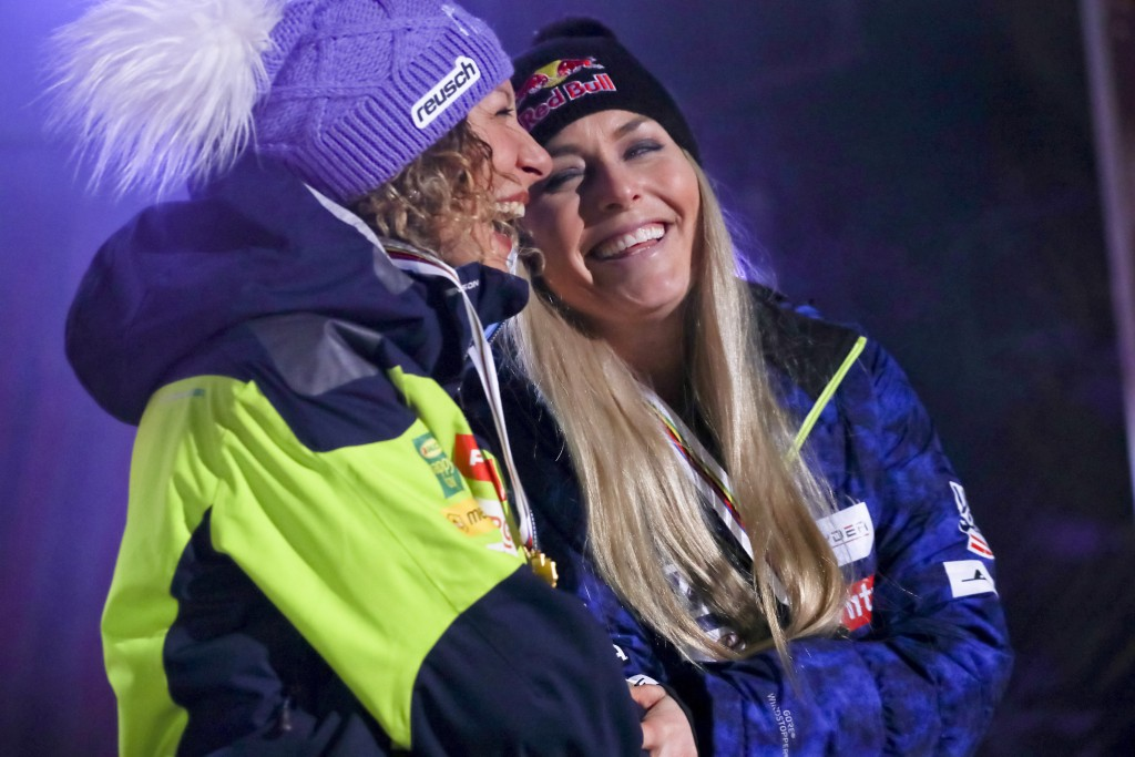 Winner Slovenia's Ilka Stuhec, left, and third placed United States' Lindsey Vonn share a laugh during the medal ceremony for the women's downhill rac...