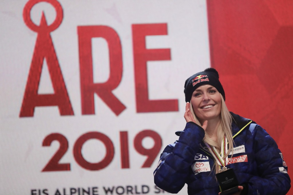Third placed United States' Lindsey Vonn poses during the medal ceremony for the women's downhill race at the alpine ski World Championships in Are, S...