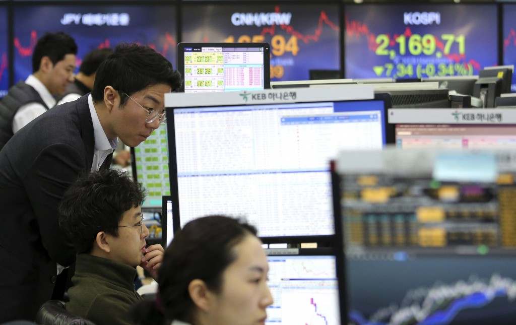 Currency traders watch monitors at the foreign exchange dealing room of the KEB Hana Bank headquarters in Seoul, South Korea, Monday, Feb. 11, 2019. A...