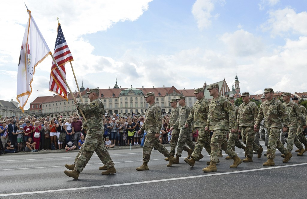 FILE - In this Wednesday, Aug. 15, 2018 file photo, a group of US Army soldiers take part in an annual military parade celebrating Polish Army Day in
