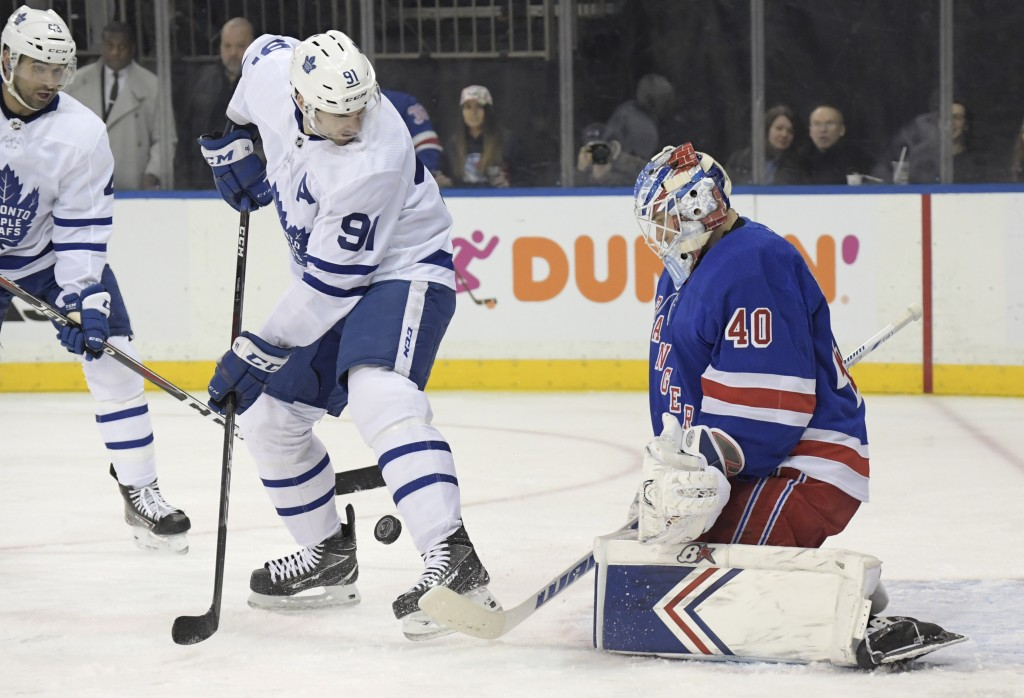 New York Rangers goaltender Alexandar Georgiev (40) makes a save as Toronto Maple Leafs center John Tavares (91) looks for the rebound during the firs...
