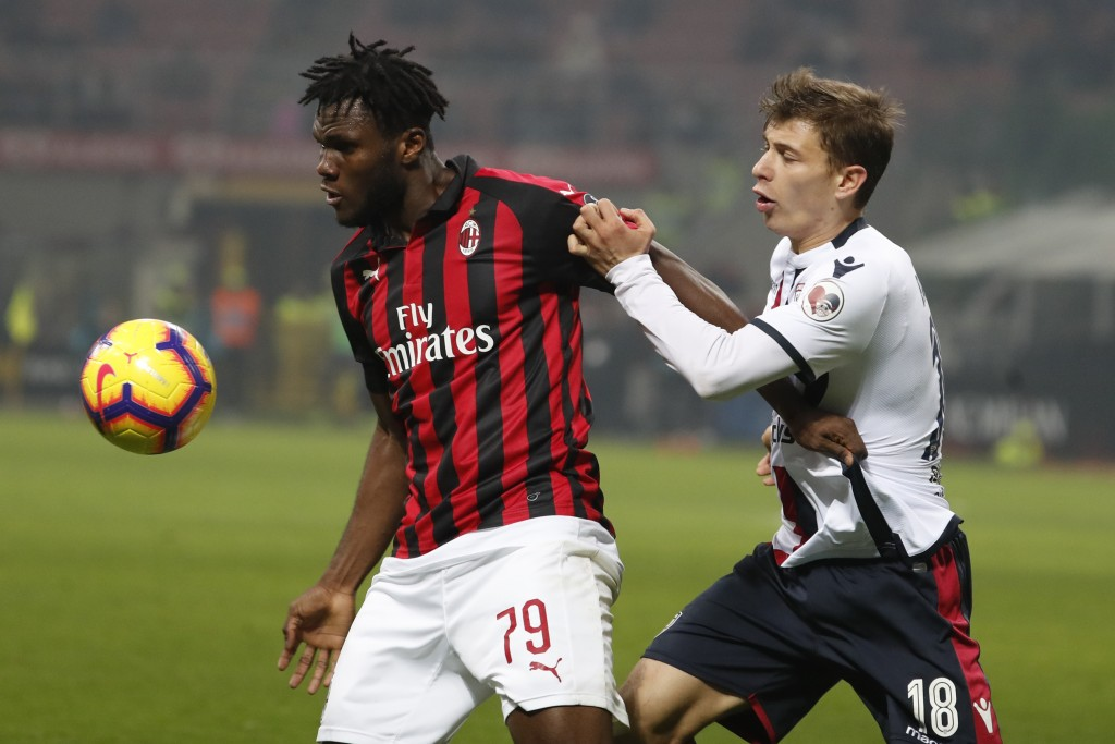 AC Milan's Franck Kessie, left, and Cagliari's Nicolo Barella challenge for the ball during the Serie A soccer match between AC Milan and Cagliari at