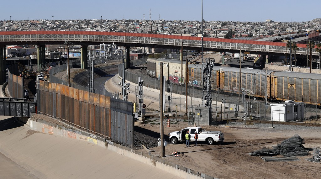 In this Tuesday, Jan. 22, 2019, photo, a new barrier is built along the Texas-Mexico border near downtown El Paso. Such barriers have been a part of E...