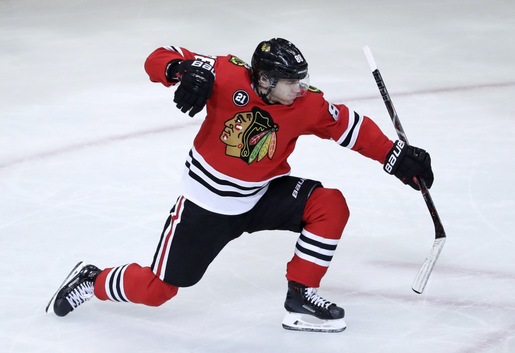 Chicago Blackhawks right wing Patrick Kane celebrates after scoring a goal against the Detroit Red Wings during the third period of an NHL hockey game