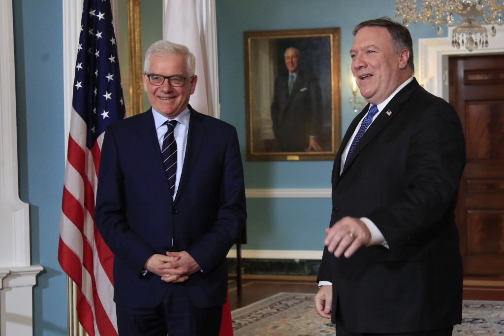 FILE - In this Monday, May 21, 2018 file photo, Secretary of State Mike Pompeo, right, meets with Polish Foreign Minister Jacek Czaputowicz at the Sta