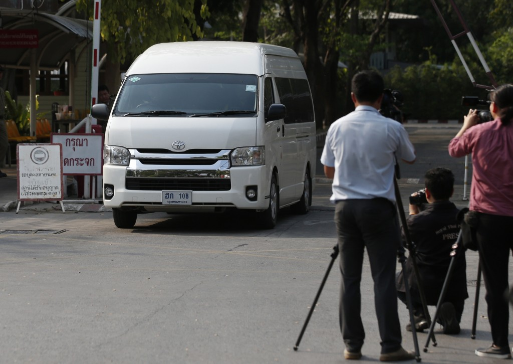 A van believed to be carrying refugee soccer player Bahraini Hakeem al-Araibi leaves a prison, Monday, Feb. 11, 2019, in Bangkok, Thailand. A Thai cou...
