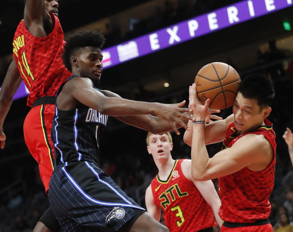 Orlando Magic forward Jonathan Isaac (1) and Atlanta Hawks guard Jeremy Lin (7) fight for a rebound during the second half of an NBA basketball game S...