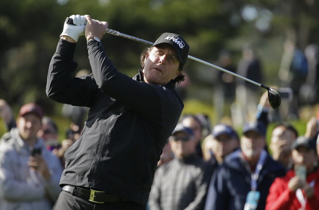 Phil Mickelson follows his drive from the fourth tee of the Pebble Beach Golf Links during the final round of the AT&T Pebble Beach Pro-Am golf tourna...